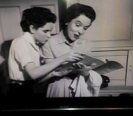 Betty and Margaret consult the Springfield phone book.